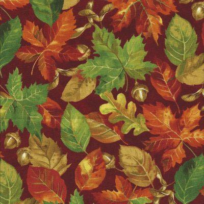 Donkerrode stof met herfstbladeren.