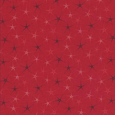 Rode stof met zwarte ,rode en witte sterren